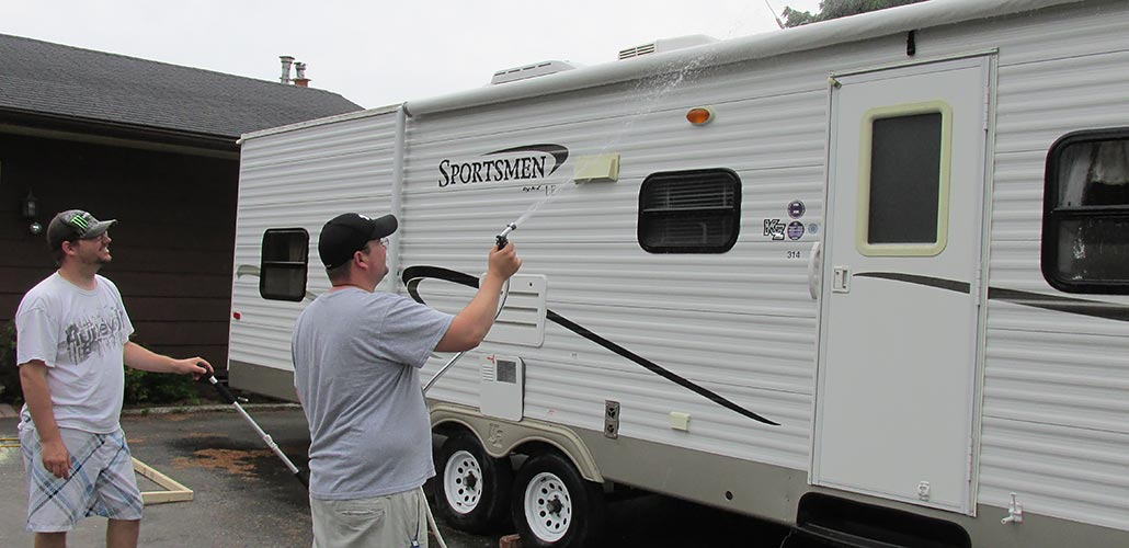 washing a camping trailer